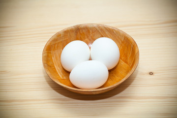 white chicken eggs in a plate