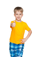 Smiling little boy with his thumb up
