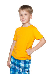 Little blond boy in a yellow shirt