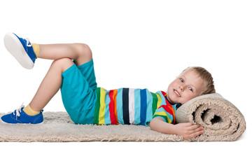 Cute little boy rests on the carpet