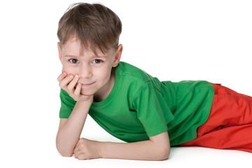 Pensive little boy rests