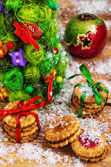Christmas cookies on the background of decorated Christmas trees
