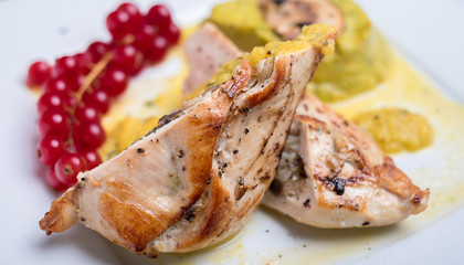 Stuffed chicken with vegetable puree and red currant