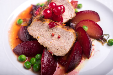 Pork fillet with apples, peas and red currant