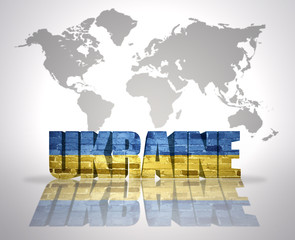 Word Ukraine on a world map background