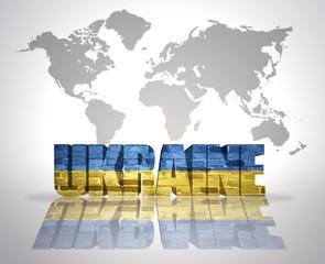 Word Ukraine on a world map background
