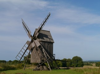 A historic wooden wind mill at the countryside of Oeland