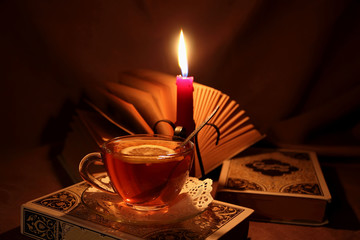 Open book and a cup of hot tea.