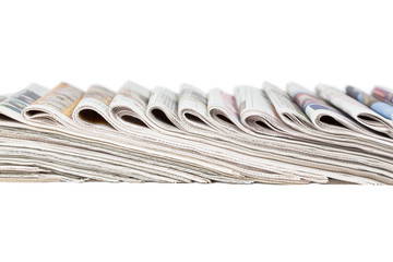 Assortment of folded newspapers
