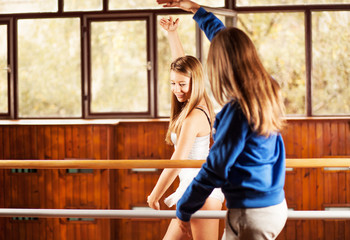 Teenage girl on ballet class with teacher