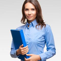 Businesswoman with blue folder, against grey