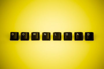 download word written with black computer buttons over yellow