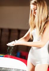 Teenage girl on gymnastic training with magnesium powder.