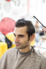 Young man at hairdresser