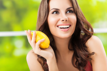 Happy smiling young woman with limon, outdoor