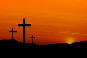 Crosses on a Hill Against an Orange Sunset