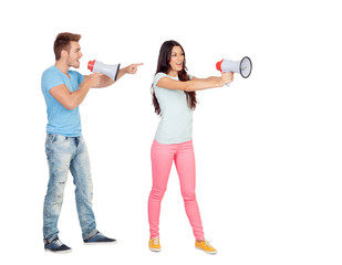 Young couple shouting with megaphones