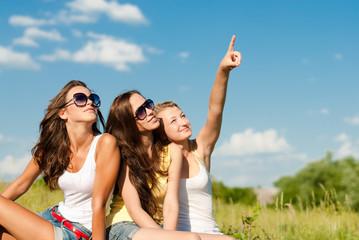 Summer fun of three happy girls