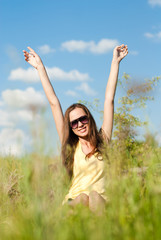 Happy teen girl having fun in grass