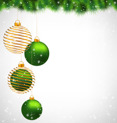 Two green and two spiral golden Christmas balls hanging on pine