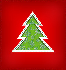 Green Christmas tree cutout on red background