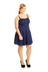 Plus size woman posing in skirt