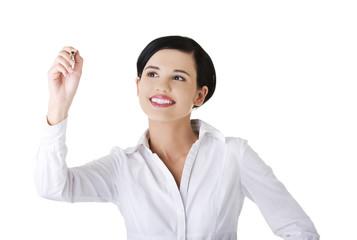 Businesswoman drawing on a glassboard