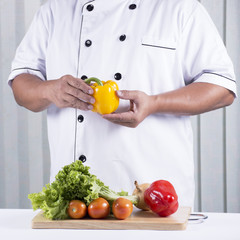 Chef holds bell pepper