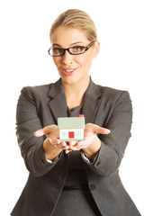 Businesswoman holding a house model