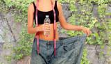 Thin woman stuck in huge pants