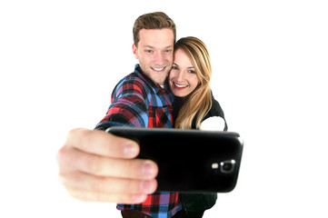 American couple in love taking romantic selfie together