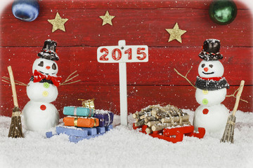 Two snowmen and one signpost with 2015 number