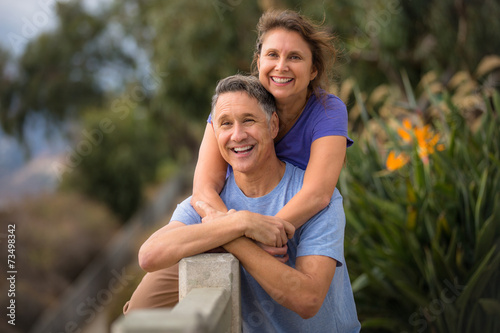 Tuinposter Ontspanning Portrait of a beautiful senior fifties couple