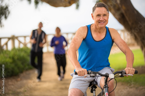 People exercising outside in the summer - 73498538