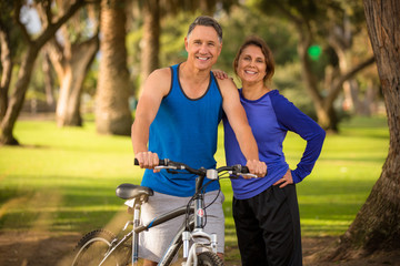 Happy fit elder couple at the park