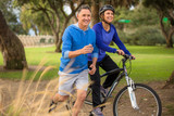 Elder couple exercising in the park poster