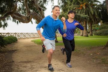 Elder couple running in the park