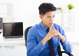 Young asian businessman  thinking plan in the office