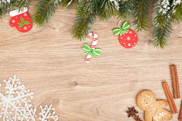 Christmas fir tree, gingerbread cookie and decor