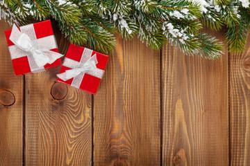 Christmas gift boxes and snow fir tree