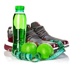 Fitness, weight loss concept with sneakers