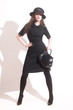 Stylish woman black dress hat with handbag