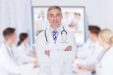 Doctor With Arms Crossed In Meeting Room