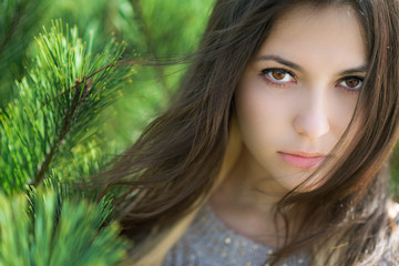 Beautiful brunette portrait. Close-up. Shallow depth of field.