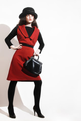 Stylish woman black red dress fashion in hat with handbag