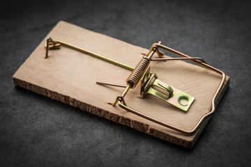 Mousetrap on dark background. Selective focus.