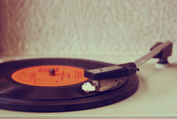 image of old record player, image is retro filtered . selective
