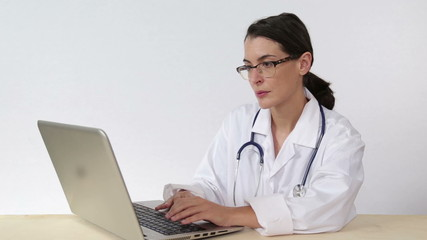 Doctor use laptop computer to perform medical research online
