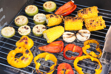 Vegetables on barbecue grill, close-up