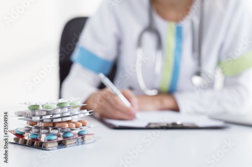 Doctor writing many medicine prescriptions плакат